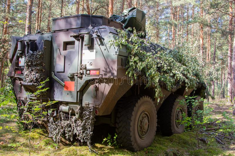 Armoured personnel carrier from german army. Stands in a military training area stock images