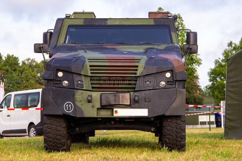 Armoured vehicle from german army stands on a field. Wheeled armoured vehicle from german army stands on a field royalty free stock photography