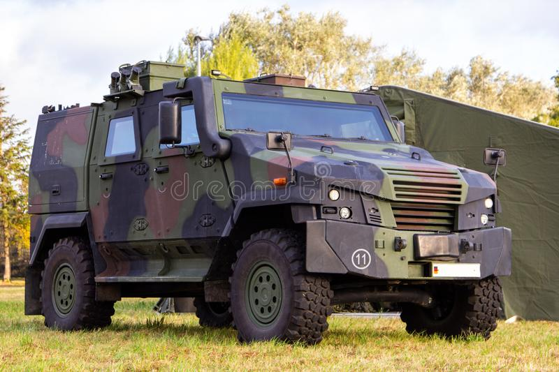Armoured vehicle from german army stands on a field. Wheeled armoured vehicle from german army stands on a field stock image