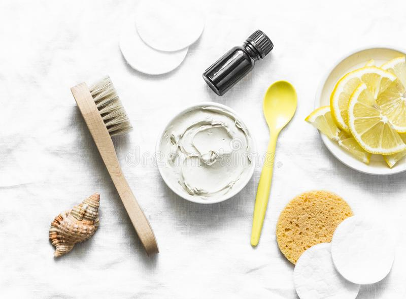 Armpit detox mask with white clay, tea tree essential oil and lemon on a light background stock image
