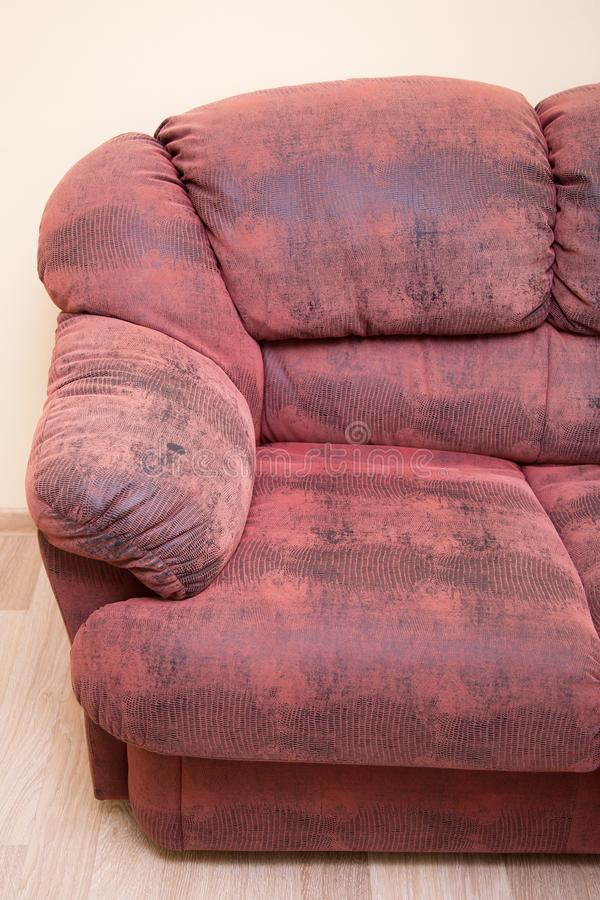 Armrest of red sofa. Picture of half leather red couch. Soft place for rest stock image