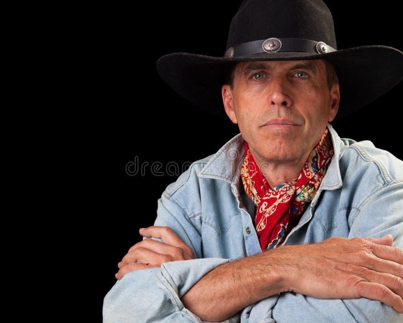 arms den korsade cowboyen arkivfoton
