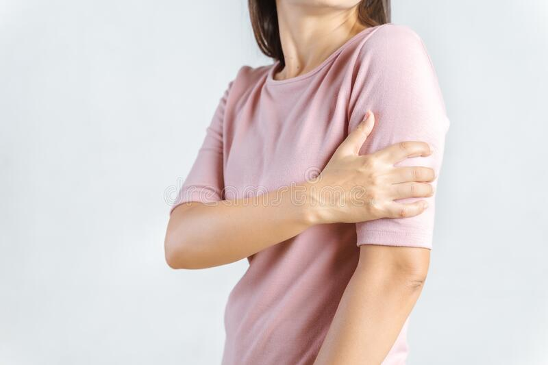 Arms Pain. Beautiful Woman Suffering From Painful Feeling In Arm Muscles. Healthcare and medical concept.  stock images