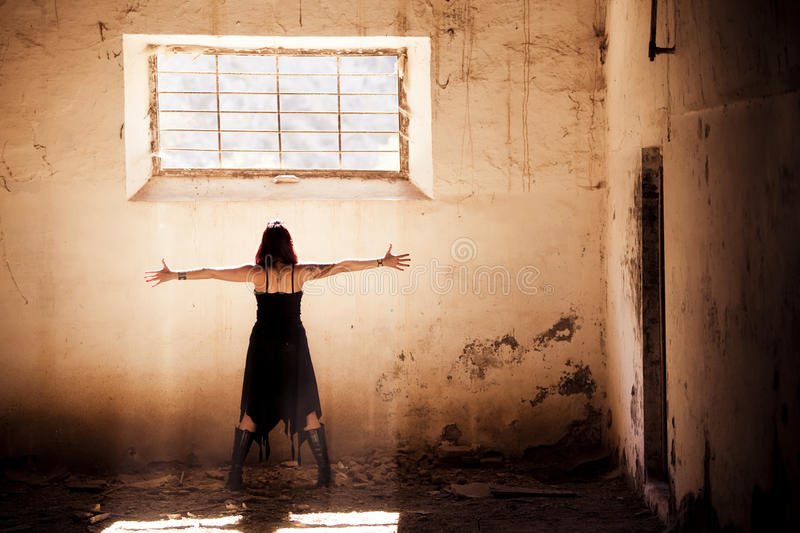 Arms raised gothic girl stock photography
