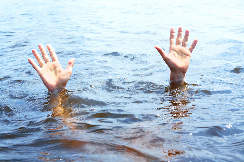 Arms in water royalty free stock photo