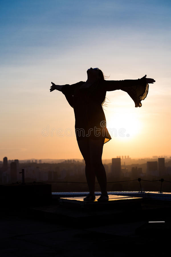 Arms wide open. Woman with arms wide open to celebrate the life royalty free stock image