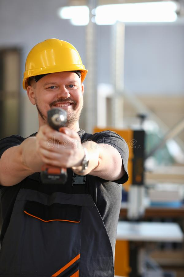 Arms of worker using electric drill closeup royalty free stock photography