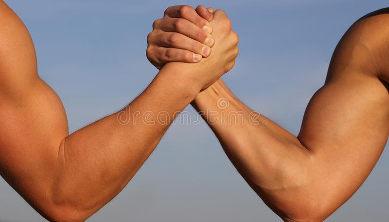 Arms wrestling, competition, strength comparison. Vs. People, leisure, challenge. Rivalry concept - close up of male stock image