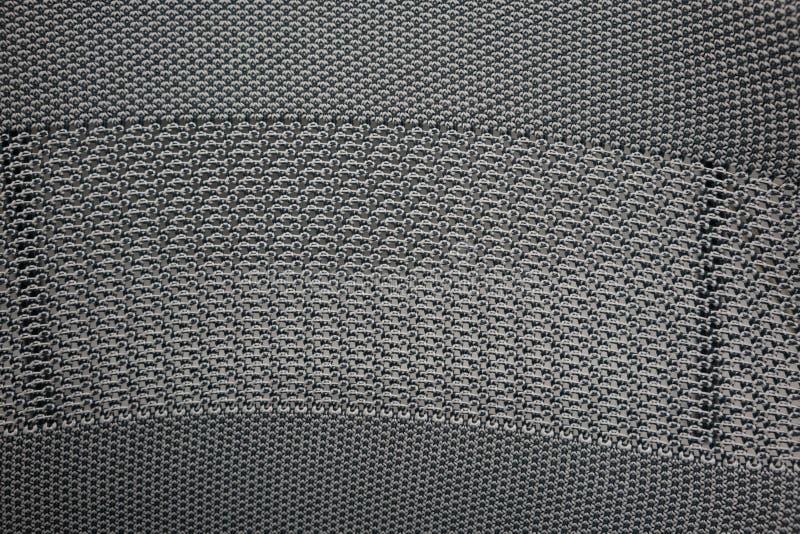 Armure en nylon synthétique noire et grise de tissu pour la texture photo libre de droits
