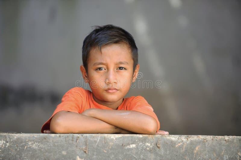 Armut-Kind lizenzfreie stockbilder