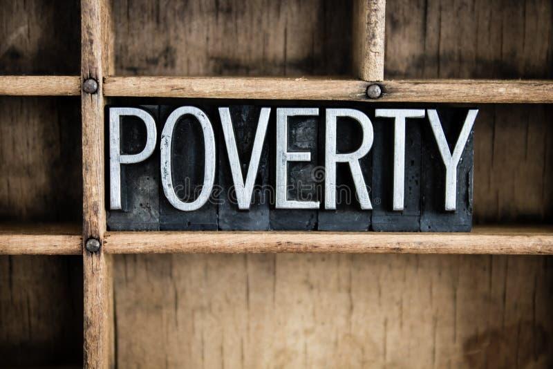 Armut-Konzept-Metallbriefbeschwerer-Wort im Fach lizenzfreie stockfotos