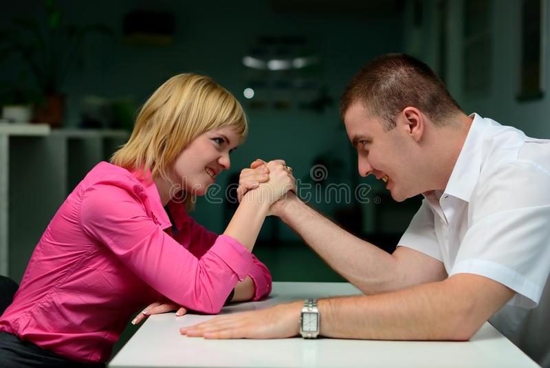 Armwrestling. In the office. girl vs guy royalty free stock images