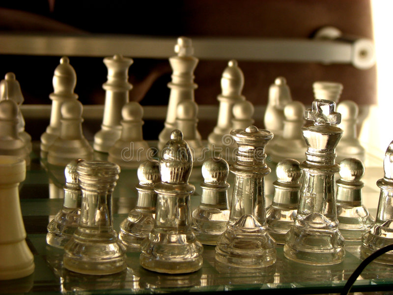 Army. The chessboard with transparent players royalty free stock image