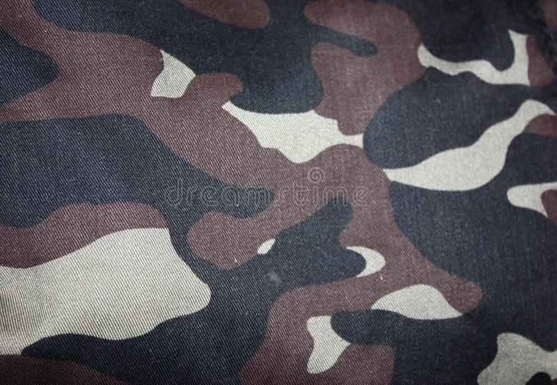 Texture of fabric with a camouflage painted in colors of the marsh. Army background image. Textile pattern of military stock image