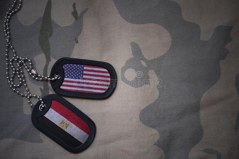 Army blank, dog tag with flag of united states of america and egypt on the khaki texture background. Military concept royalty free stock photo