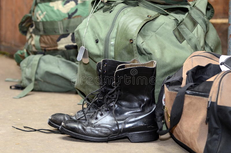 Army boots with duffle bag and dog tags royalty free stock photos
