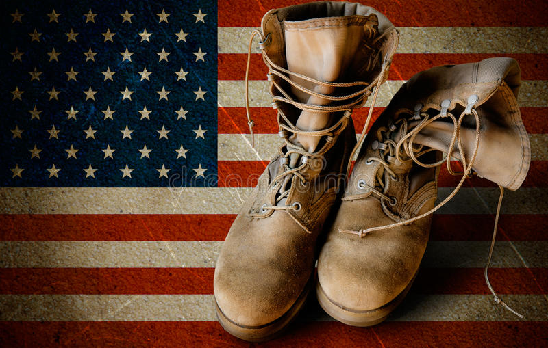 Army boots on sandy flag background. Grunge US Army boots on sandy american flag background collage stock photos