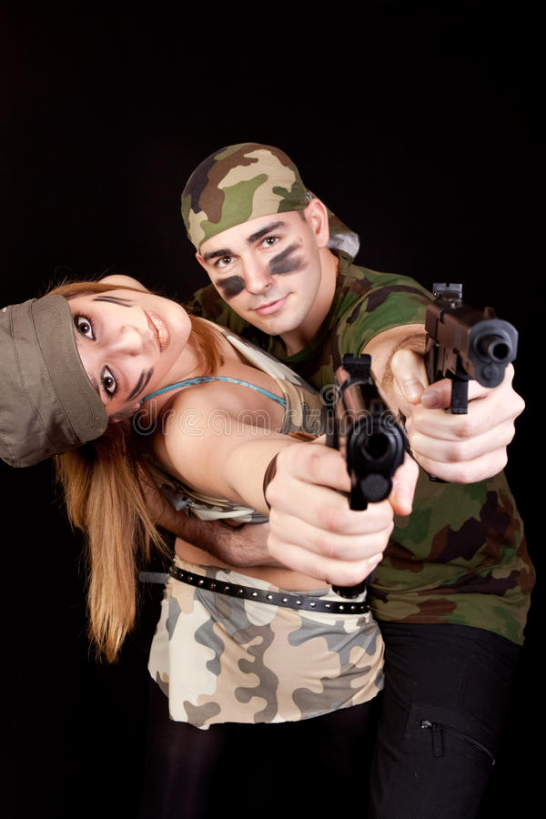 Army Couple With Guns Royalty Free Stock Images