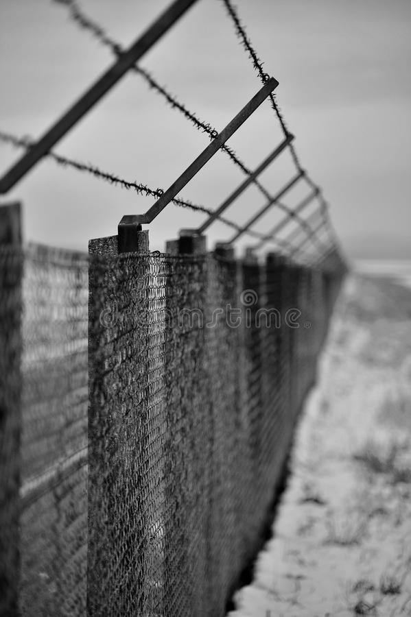 Army fences in danger zone royalty free stock image