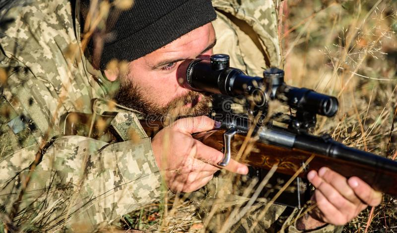 Army forces. Camouflage. Bearded man hunter. Hunting skills and weapon equipment. How turn hunting into hobby. Military stock images
