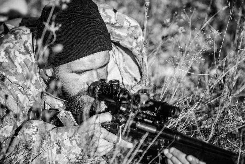 Army forces. Camouflage. Military uniform fashion. Bearded man hunter. Hunting skills and weapon equipment. How turn. Hunting into hobby. Man hunter with rifle stock images