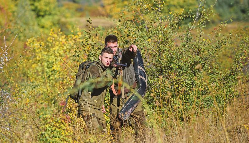 Army forces. Camouflage. Military uniform fashion. Hunting skills and weapon equipment. How turn hunting into hobby. Man. Hunters with rifle gun. Boot camp stock photos