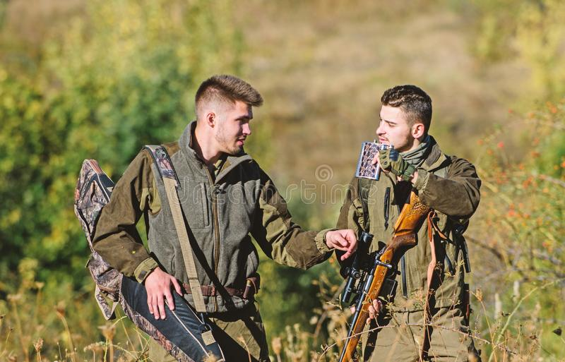 Army forces. Camouflage. Military uniform. Friendship of men hunters. Hunting skills weapon equipment. How turn hunting. Into hobby. Man hunters with rifle gun stock photos