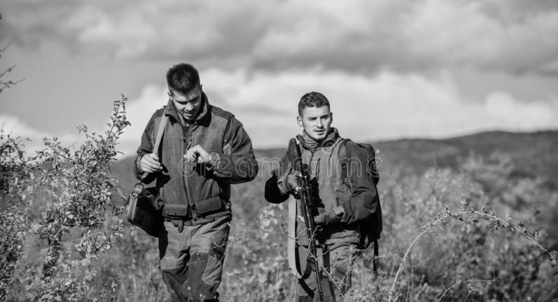 Army forces. Camouflage. Military uniform. Man hunters with rifle gun. Boot camp. Hunting skills and weapon equipment. How turn hunting into hobby. Friendship stock photo