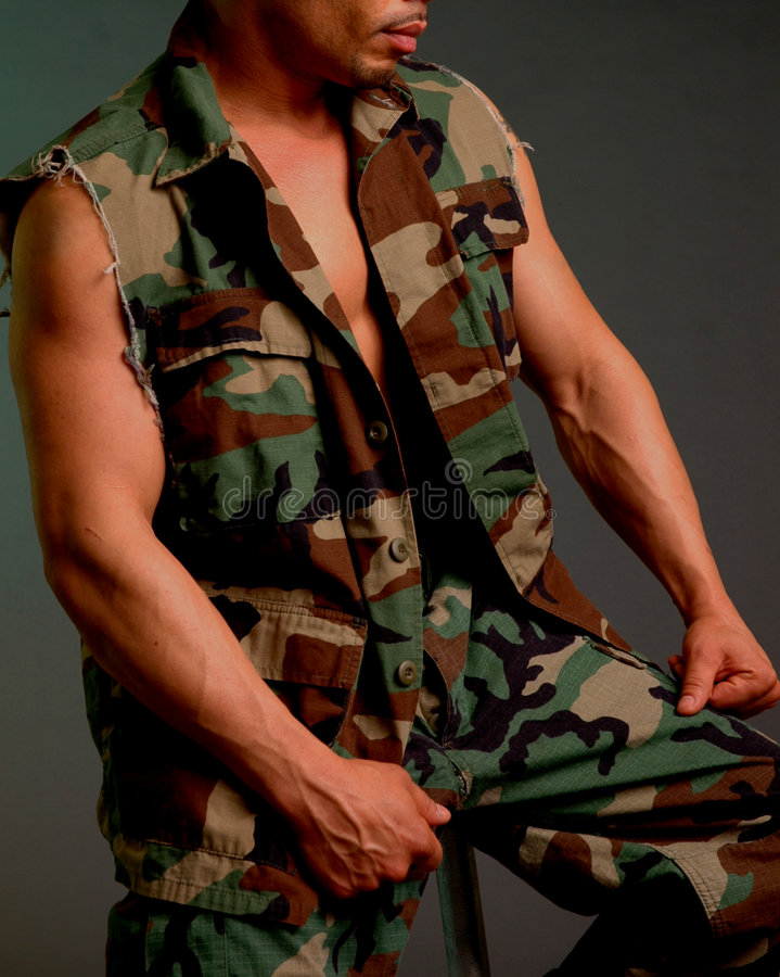 Army guy. Male in army fatigues stock image
