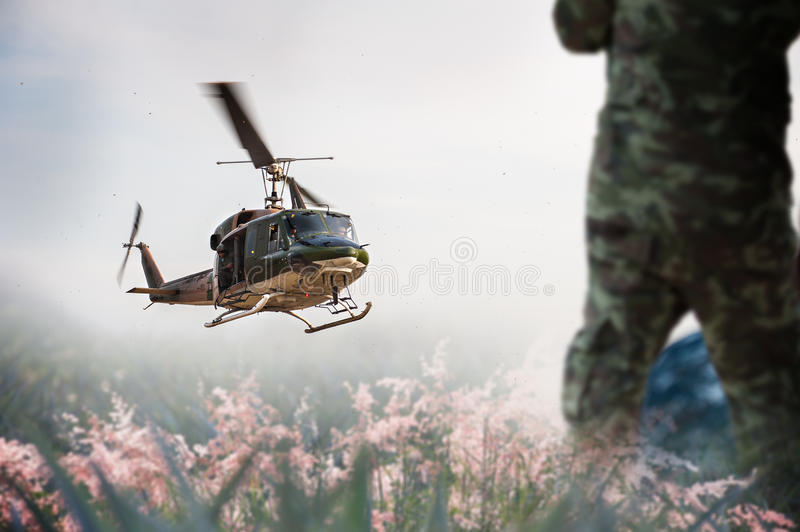 Army Helicopter is landing on the open field stock photo