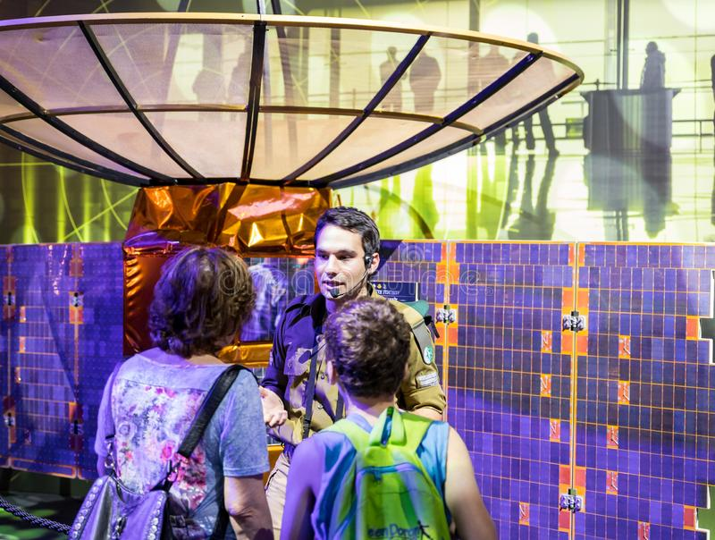 Army instructor tells visitors about the principle of the satellite dish at the army exhibition `Our IDF` royalty free stock images