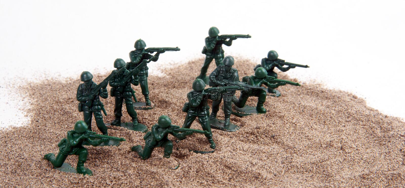 Army Men Toy Figurines Sand White royalty free stock photo