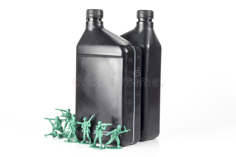 Army Men Oil. Toy army men with quart of oil symbolizing oil war in Middle East royalty free stock photos