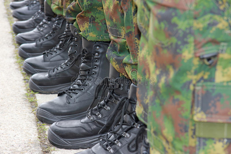 Army, Military Boots. Soldiers standing in a row, military boots stock photo