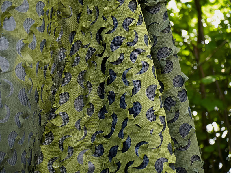Army military hunting birding camouflage net stock photo