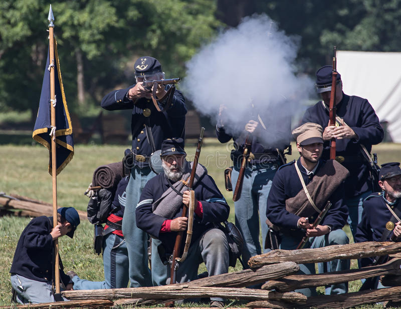 Army of the North in Battle. Civil War era soldiers in battle at the Dog Island reenactment in Red Bluff, California royalty free stock images