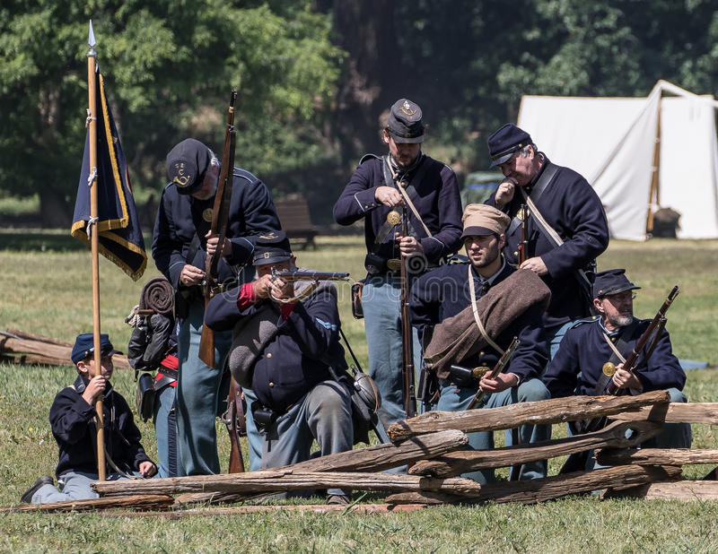 Army of the North in Battle. Civil War era soldiers in battle at the Dog Island reenactment in Red Bluff, California royalty free stock photography