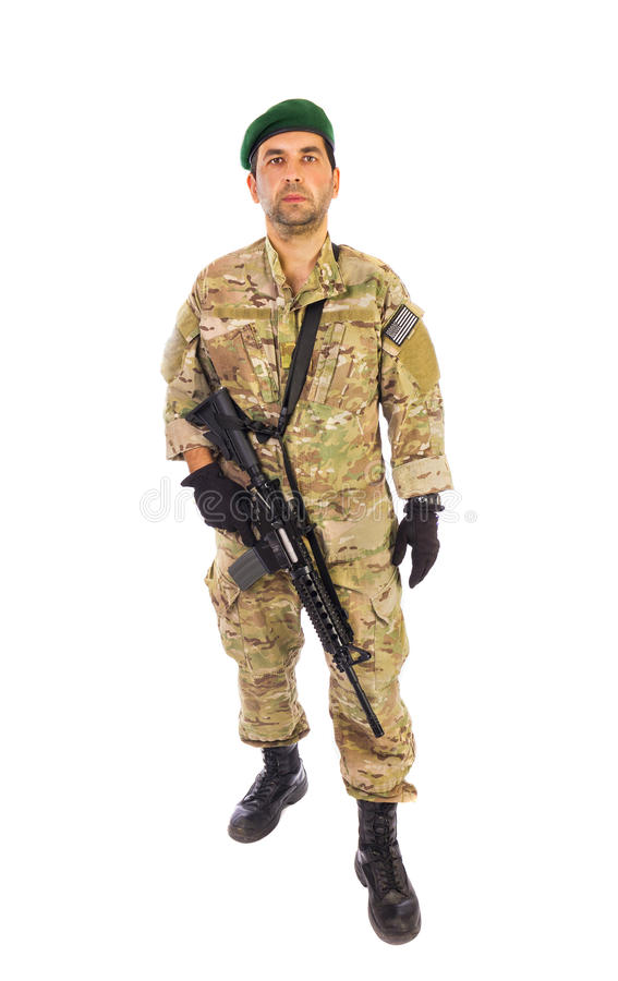 Army personnel portrait walking towards you. Army soldier portrait walking towards you with green beret and assault riffle slinged on isolated over white royalty free stock images