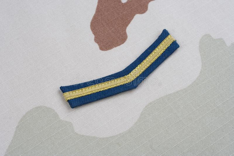 ARMY Private rank patch on desert uniform. Background stock images