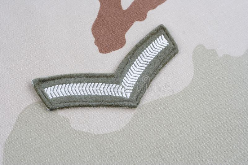 ARMY Private rank patch on desert uniform. Background royalty free stock photography