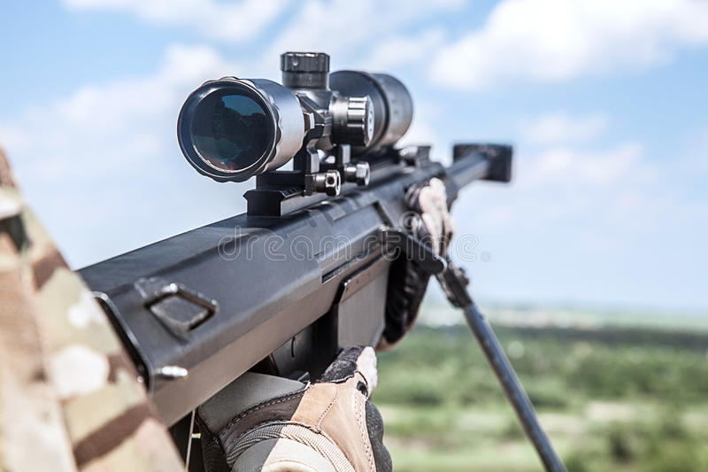 Army ranger sniper. US Army ranger sniper with huge rifle royalty free stock photography