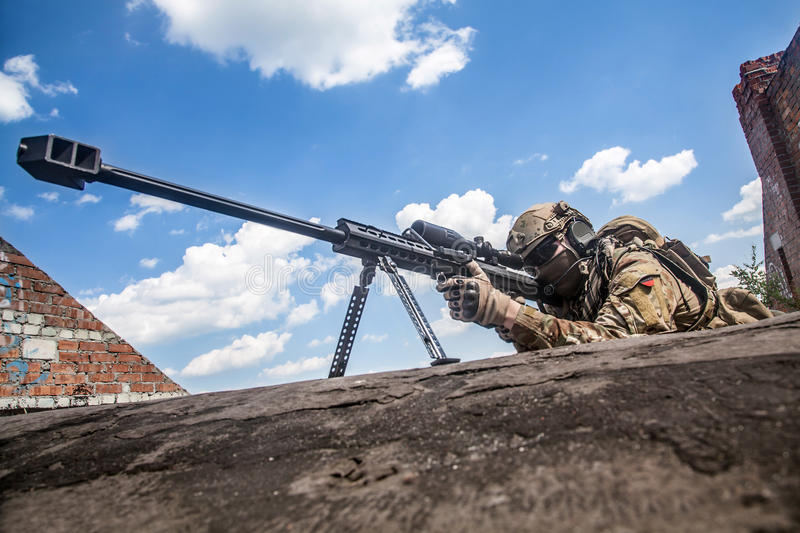 Army ranger sniper. US Army ranger sniper with huge rifle royalty free stock photo
