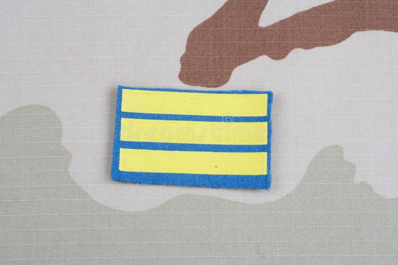 ARMY Sergeant rank patch on desert uniform. Background royalty free stock images