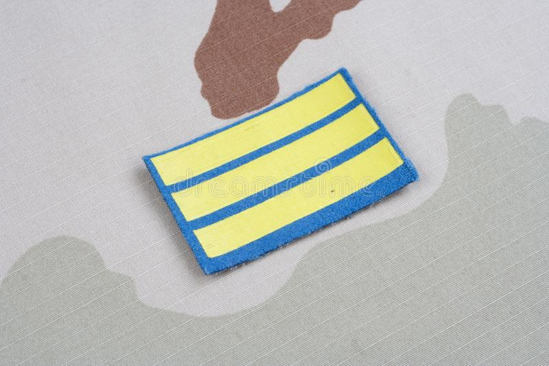 ARMY Sergeant rank patch on desert uniform. Background royalty free stock photos