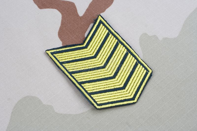 ARMY Sergeant rank patch on desert uniform. Background stock image