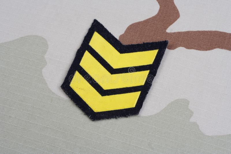 ARMY Sergeant rank patch on desert uniform. Background stock photography
