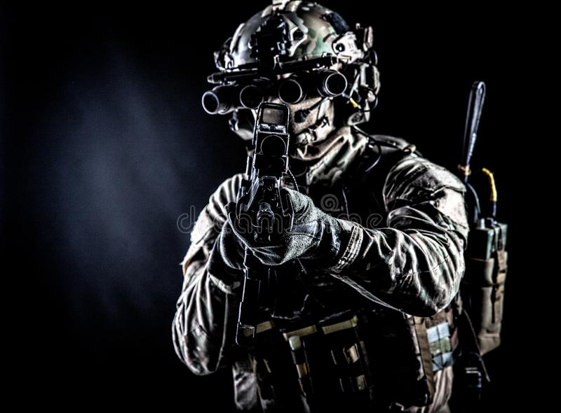 Army soldier aiming rifle in camera in darkness stock photos