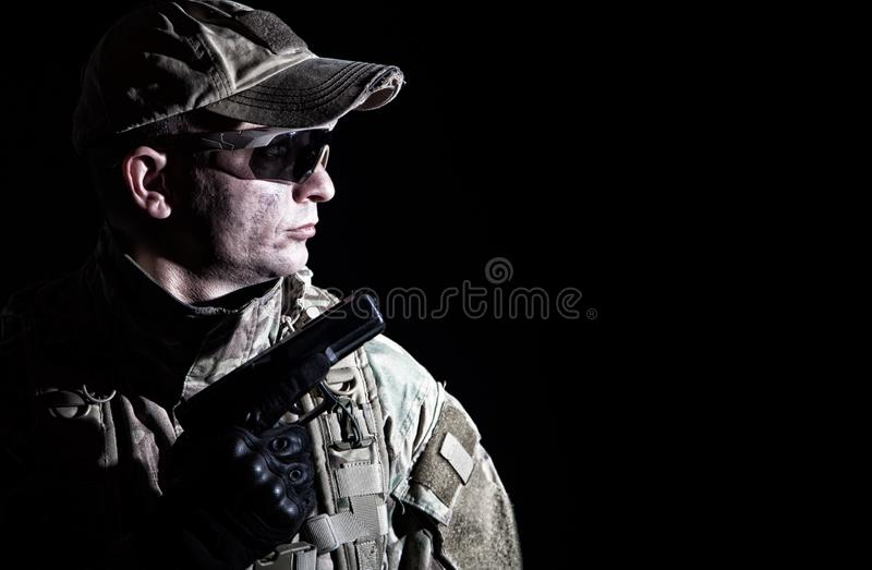 Portrait of army soldier armed service pistol royalty free stock photography
