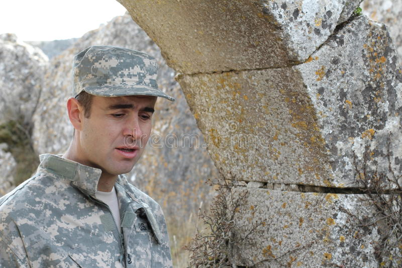 Army soldier crying during an overseas mission royalty free stock photography