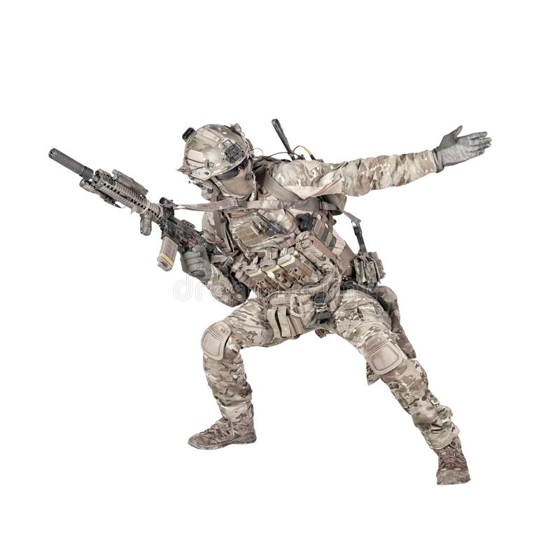 Army soldier going in attack isolated studio shoot. Army soldier, modern combatant, fireteam sergeant in battle uniform and helmet, armed with service rifle royalty free stock photos